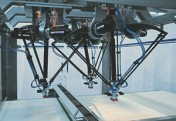 A multi-robot pick-and-place machine governed by a single Rexroth controller