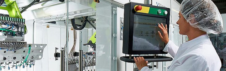 Worker controlling Bosch packaging and processing equipment